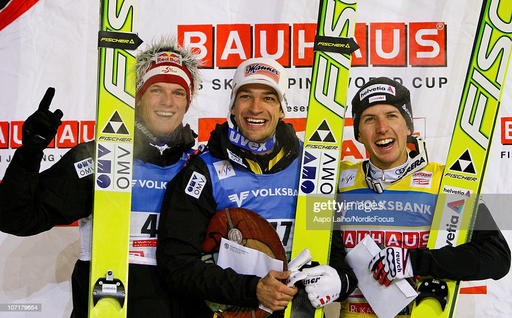 Thomas Morgenstern of Austria, Andreas Kofler of Austria and Simon Ammann of Switzerland (L-R) pose on the podium in the individual HS142 during the FIS Ski Jumping World Cup on November 28, 2010, in Kuusamo, Finland.