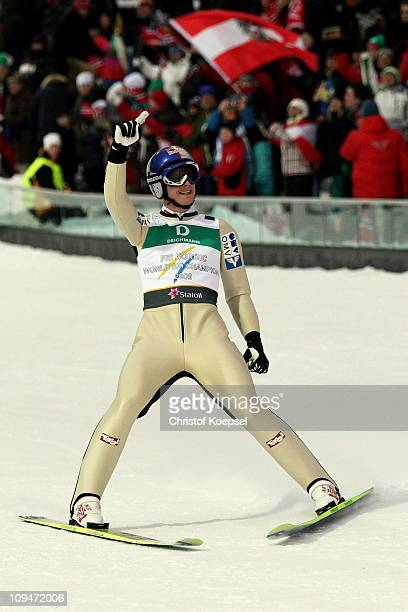 Thomas Morgenstern of Austria celebrates after landing the final jump to win the gold medal for his team in the Men's Ski Jumping Team HS106...