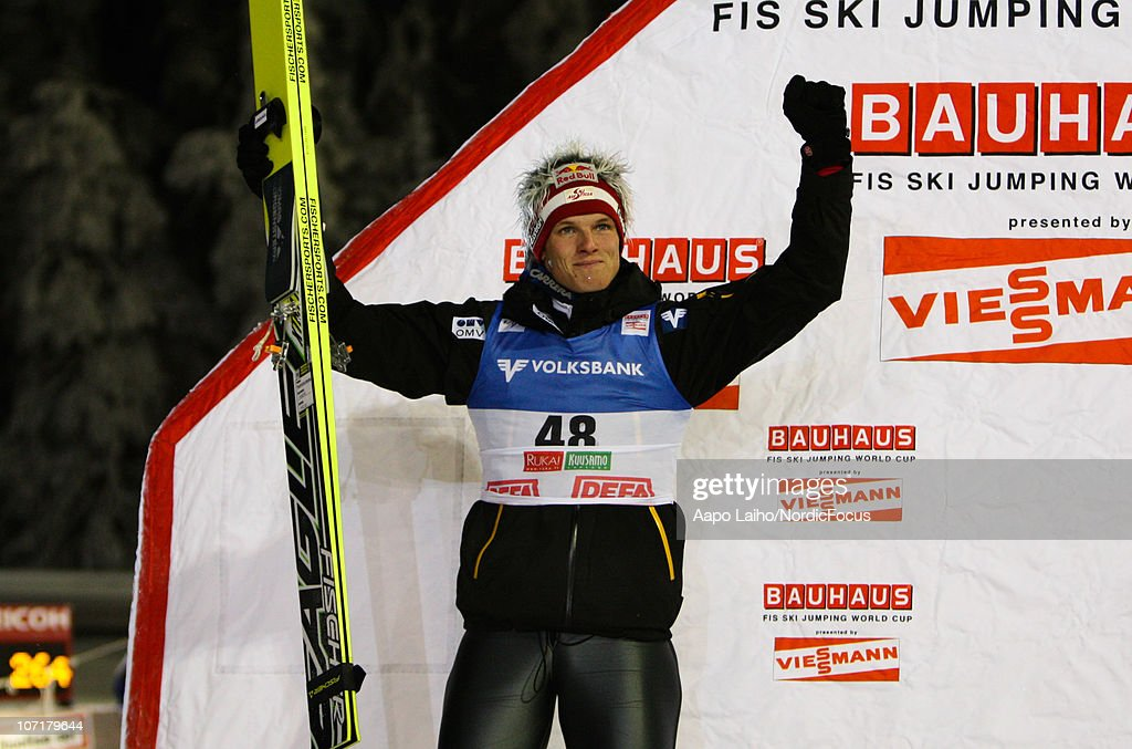 Thomas Morgenstern of Austria celebrates on the podium in the individual HS142 during the FIS Ski Jumping World Cup on November 28, 2010, in Kuusamo, Finland.