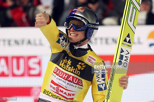 Thomas Morgenstern of Austria celebrates winning the 59th Four Hills ski jumping tournament after the final round of the FIS Ski Jumping World Cup...