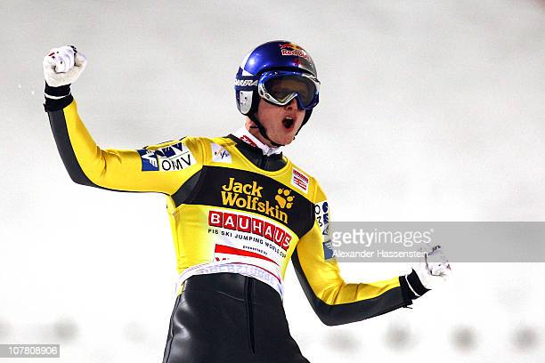 Thomas Morgenstern of Austria celebrates winning the final round for the FIS Ski Jumping World Cup event at the 59th Four Hills ski jumping...