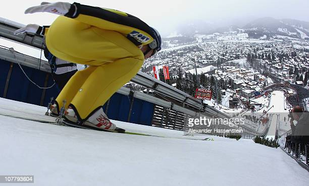 Thomas Morgenstern of Austria competes at the training round for the FIS Ski Jumping World Cup event at the 59th Four Hills ski jumping tournament at...