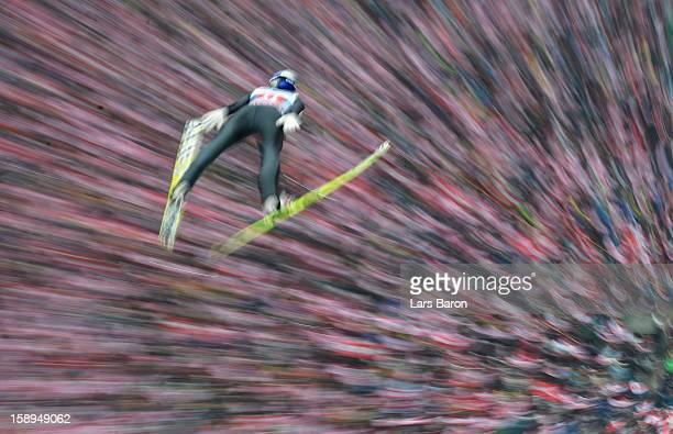 Thomas Morgenstern of Austria competes during the first round for the FIS Ski Jumping World Cup event of the 61st Four Hills ski jumping tournament...
