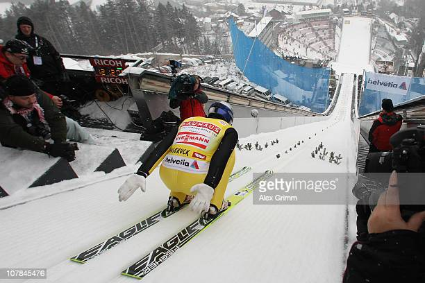 Thomas Morgenstern of Austria competes during the training for the FIS Ski Jumping World Cup event of the 59th Four Hills ski jumping tournament at...