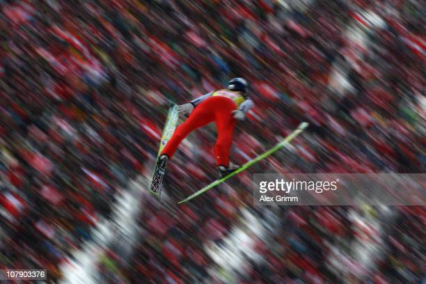 Thomas Morgenstern of Austria competes during trial round for the FIS Ski Jumping World Cup event of the 59th Four Hills ski jumping tournament at...