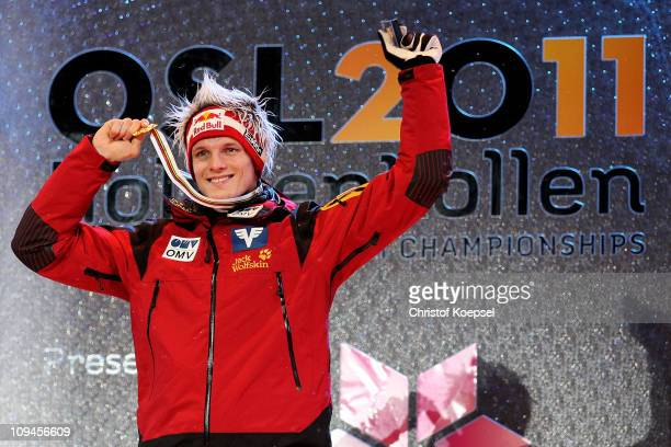 Thomas Morgenstern of Austria poses with the gold medal won in the Men's Ski Jumping HS106 competition during the FIS Nordic World Ski Championships...