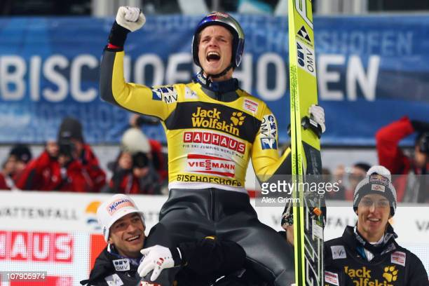 Thomas Morgenstern of Austria sits on the shoulders of his team mates as he celebrates winning the 59th Four Hills ski jumping tournament after the...