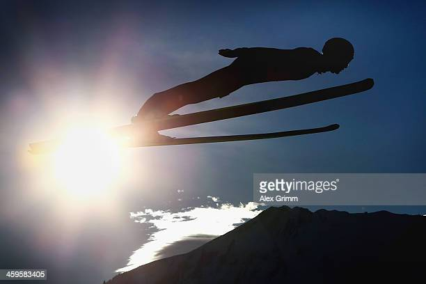 Thomas Morgenstern of Austria soars through the air during the training round on day 1 of the Four Hills Tournament Ski Jumping event at...
