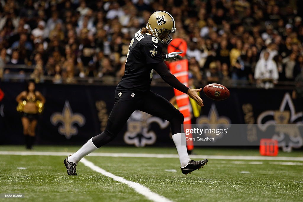 Thomas Morstead #6 of the New Orleans Saints kicks the ball against the Carolina Panthersat the Mercedes-Benz Superdome on December 30, 2012 in New Orleans, Louisiana.