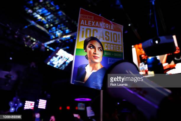 Thomas Muccioli carries a sign with the likeness of Alexandria OcasioCortez at La Boom night club in Queens on November 6 2018 in New York City...