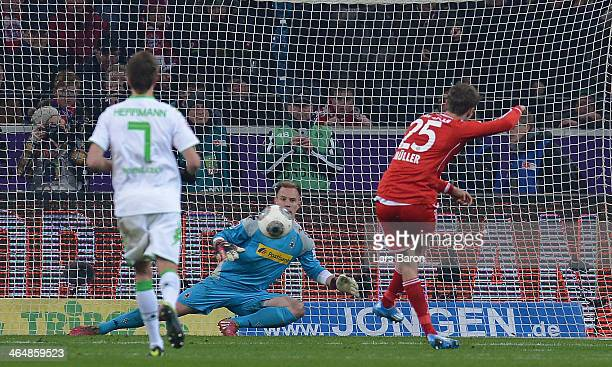 Thomas Mueler of Muenchen scores his teams second goal during the Bundesliga match between Borussia Moenchengladbach and FC Bayern Muenchen at...