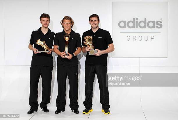Thomas Mueller adidas Golden Boot Winner Diego Forlan adidas Golden Ball Winner and Iker Casillas adidas Golden Glove Winner pose with their FIFA...
