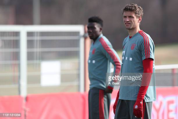 Thomas Mueller and Alphonso Davies of FC Bayern Muenchen practice during a training session at the club's Saebener Strasse training ground on...