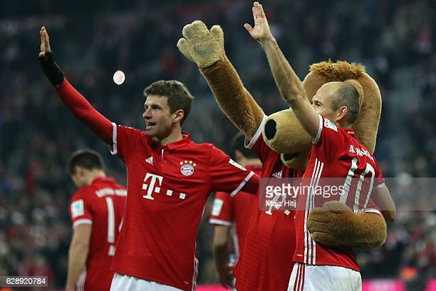 Thomas Mueller and Arjen Robben of Muenchen celebrate with mascot Bernie after the Bundesliga match between Bayern Muenchen and VfL Wolfsburg at...