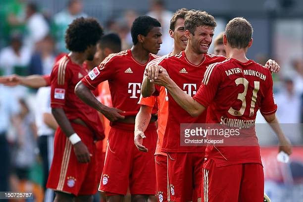 Thomas Mueller and Bastian Schweinsteiger of Bayern celebrate the 30 victory after the Bundesliga match between Greuther Fuerth and FC Bayern...