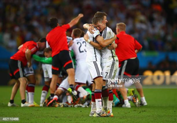 Thomas Mueller and Bastian Schweinsteiger of Germany celebrate after defeating Argentina 10 in extra time during the 2014 FIFA World Cup Brazil Final...