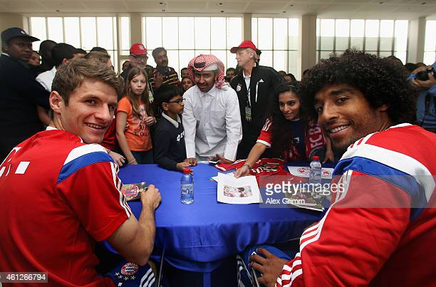Thomas Mueller and Dante attend an autograph session at the Doha Volkswagen branch during day 2 of the Bayern Muenchen training camp at ASPIRE...