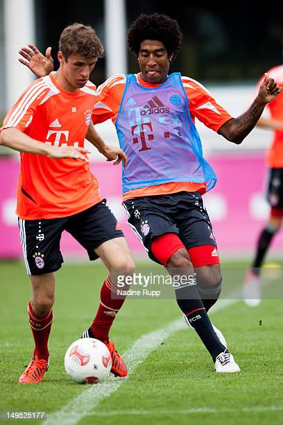 Thomas Mueller and Dante fight for the ball during a training session after the Bayern Muenchen team presentation at Bayern's training ground...
