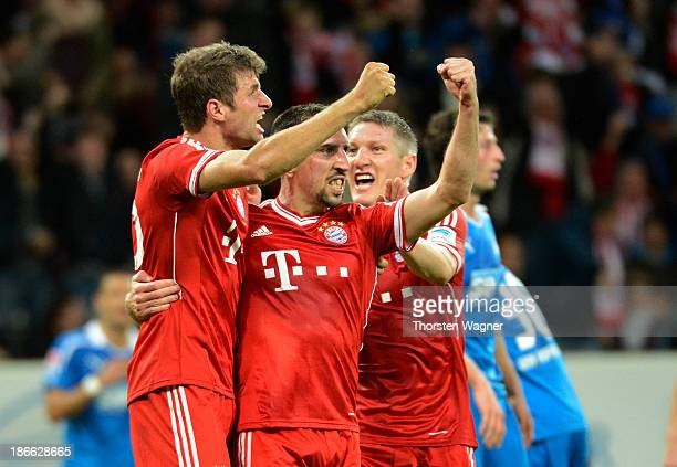 Thomas Mueller and his team mate Franck Ribery of Muenchen celebrates after scoring her team second goal during the Bundesliga match between TSG 1899...