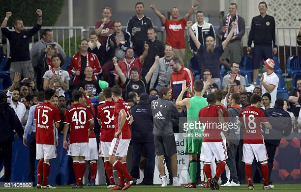Thomas Mueller and his team mates celebrate with their fans during the friendly match between Bayern Muenchen and KAS Eupen on January 10 2017 in...