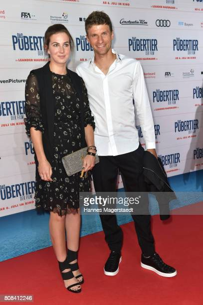 Thomas Mueller and his wife Lisa Mueller during the 'Das Pubertier' Premiere at Mathaeser Filmpalast on July 4 2017 in Munich Germany