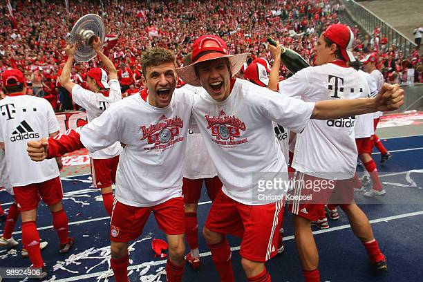 Thomas Mueller and Holger Badstuber of Bayern celebrate winning the German Champions trophy during the Bundesliga match between Hertha BSC Berlin and...