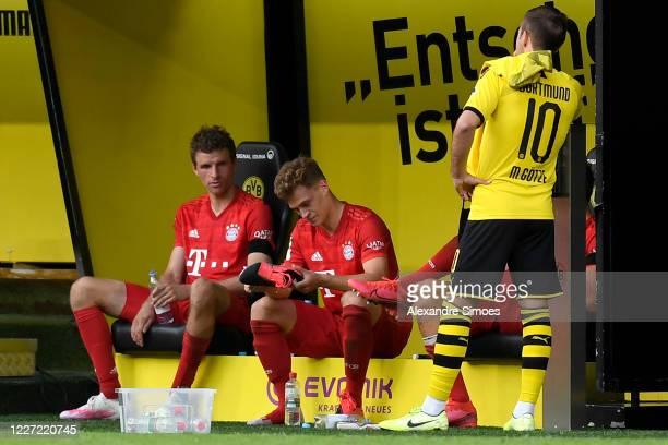Thomas Mueller and Joshua Kimmich of Bayern Muenchen and Mario Goetze of Borussia Dortmund talk after the Bundesliga match between Borussia Dortmund...