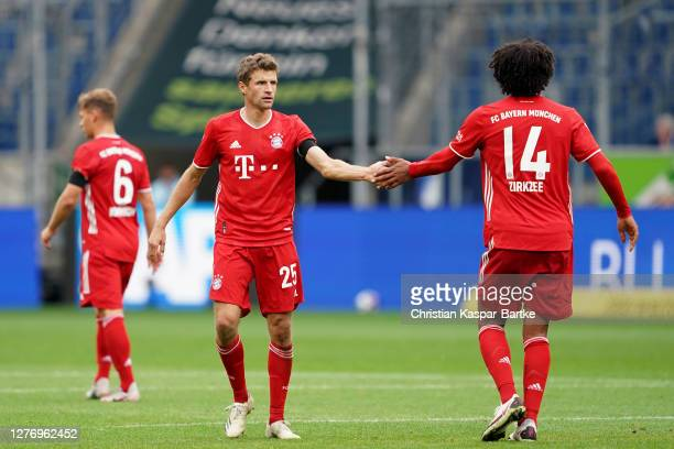 Thomas Mueller and Joshua Zirkzee celebrate their sides first goal during the Bundesliga match between TSG Hoffenheim and FC Bayern Muenchen at...