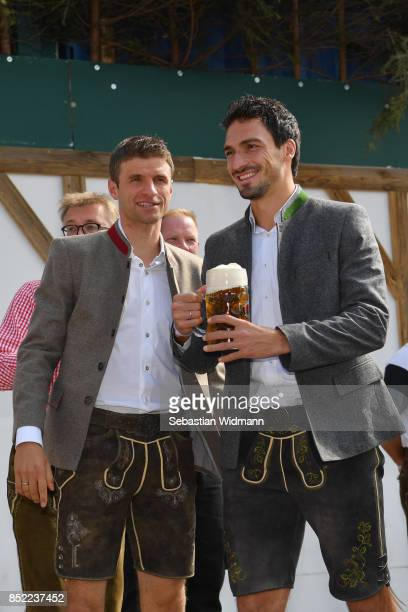 Thomas Mueller and Mats Hummels of FC Bayern Muenchen attend the Oktoberfest beer festival at Kaefer Wiesnschaenke tent at Theresienwiese on...
