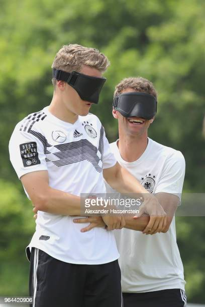 Thomas Mueller and Matthias Ginter attend a Blind Football demonstration match with national players of the German national Blind Football team at...