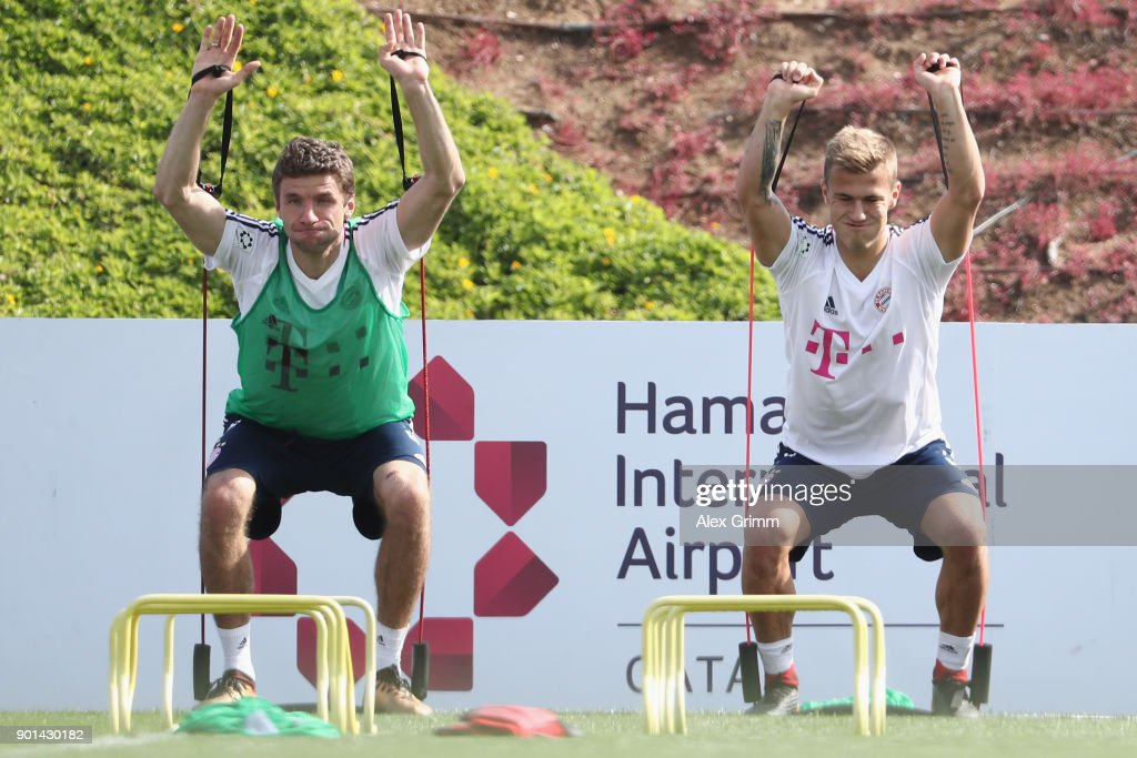 Thomas Mueller (L) and Niklas Dorsch exercise during a training session on day 4 of the FC Bayern Muenchen training camp at ASPIRE Academy for Sports Excellence on January 5, 2018 in Doha, Qatar.