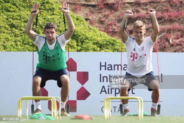 Thomas Mueller and Niklas Dorsch exercise during a training session on day 4 of the FC Bayern Muenchen training camp at ASPIRE Academy for Sports...