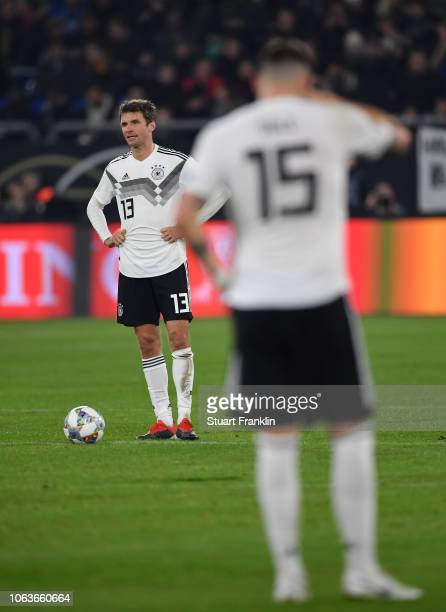 Thomas Mueller and Niklas Suele of Germany look dejected during the UEFA Nations League A group one match between Germany and Netherlands at...