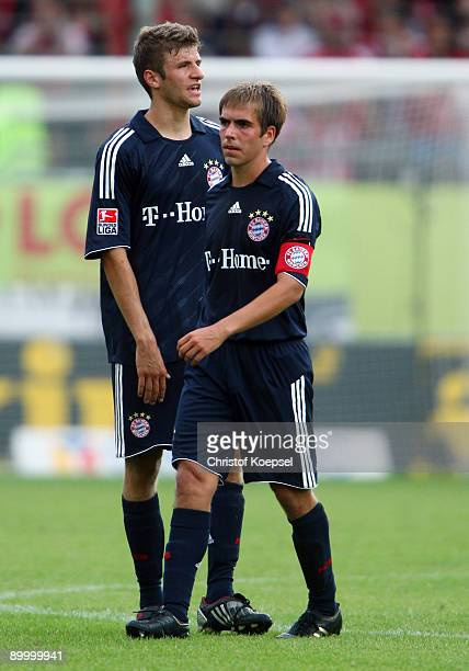 Thomas Mueller and Philipp Lahm of Bayern look dejected after losing 12 the Bundesliga match between FSV Mainz 05 and FC Bayern Muenchen at Bruchweg...