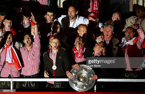 Thomas Mueller and Philipp Lahm of Bayern Muenchen celebrate with team mates the German championship title on the town hall balcony at Marienplatz on...
