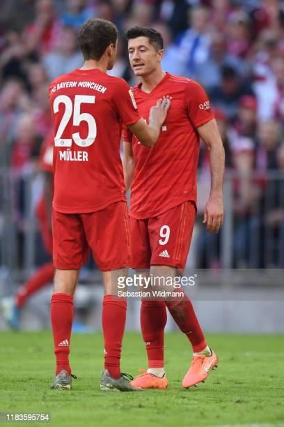 Thomas Mueller and Robert Lewandowski of Bayern Munich talk during the Bundesliga match between FC Bayern Muenchen and 1. FC Union Berlin at Allianz...
