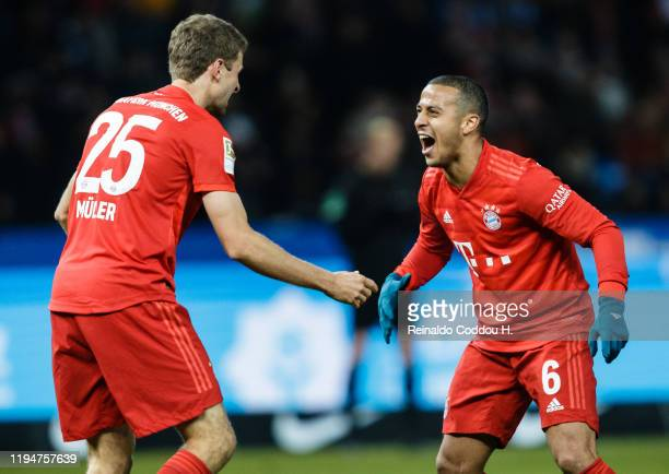 Thomas Mueller and Thiago Alcantara of Bayern Muenchen celebrate their first goal during the Bundesliga match between Hertha BSC and FC Bayern...