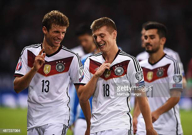 Thomas Mueller and Toni Kroos of Germany celebrate after the UEFA EURO 2016 Qualifier Group D match between Scotland and Germany at Hampden Park on...