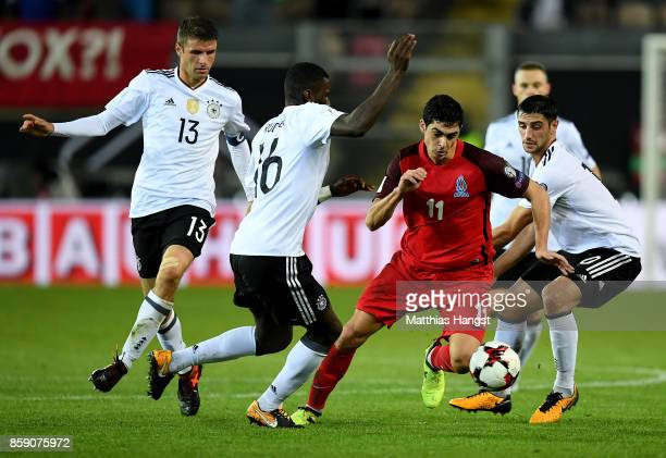 Thomas Mueller Antonio Ruediger Lars Stindl of Germany and Ramil Sheydaev of Azerbaijan battle for the ball during the FIFA 2018 World Cup Qualifier...