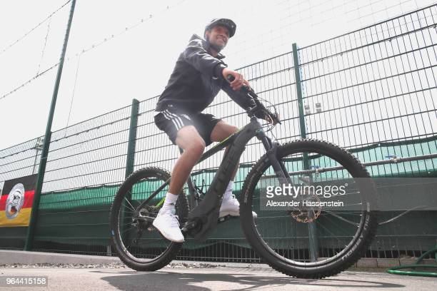 Thomas Mueller arrives with a mountain bike for a training session of the German national team at Sportanlage Rungg on day nine of the Southern Tyrol...