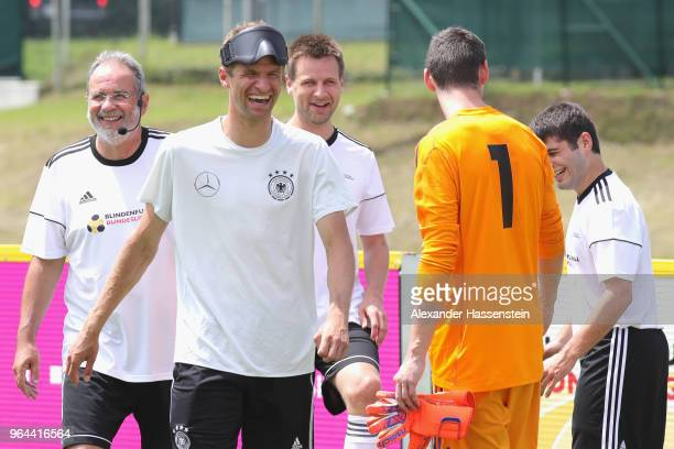 Thomas Mueller attends a Blind Football demonstration match with natioanl players of the German national Blind Football team at Sportanlage Rungg on...