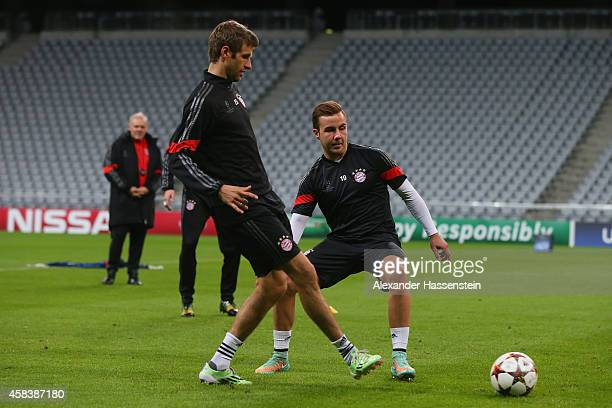 Thomas Mueller battles for the ball with his team mate Mario Goetze during a Bayern Muenchen training session prior to their UEFA Champions League...