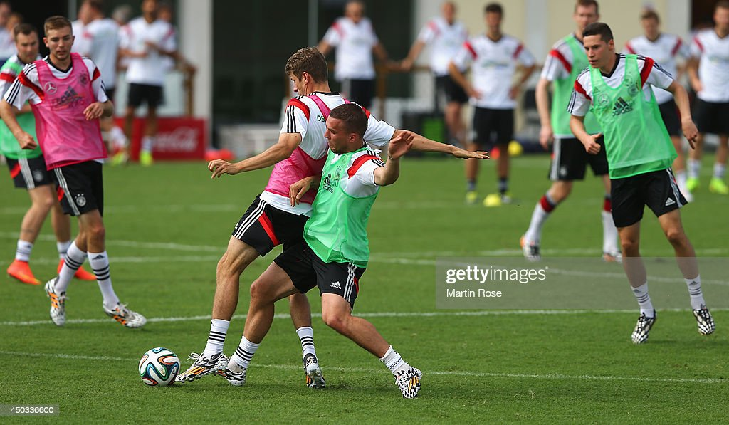 Thomas Mueller (L) battles for the ball with team mate Philipp Lahm during the German National team training session at Campo Bahia on June 9, 2014 in Santo Andre, Brazil.