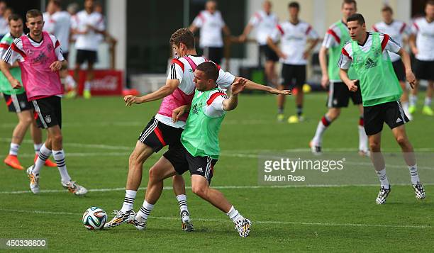 Thomas Mueller battles for the ball with team mate Philipp Lahm during the German National team training session at Campo Bahia on June 9 2014 in...