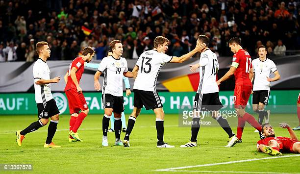 Thomas Mueller celebrates after he scores his team's opening goal during the FIFA 2018 World Cup Qualifier between Germany and Czech Republic at...