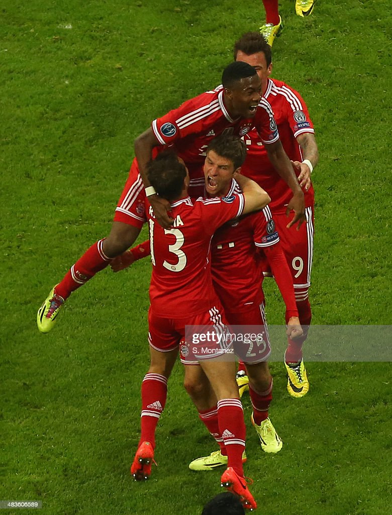 Thomas Mueller #25 celebrates with team mates after scoring his team's second goal during the UEFA Champions League quarter final second leg match between FC Bayern Muenchen and Manchester United at Allianz Arena on April 9, 2014 in Munich, Germany.