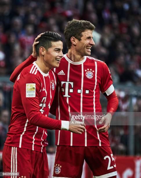 Thomas Mueller congratulates James of Bayern Munich after scoring a goal during the Bundesliga match between FC Bayern Muenchen and Borussia Dortmund...