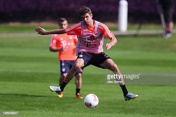 Thomas Mueller controles the ball during a Bayern Muenchen training session at the ASPIRE Academy for Sports Excellence on January 4, 2013 in Doha,...