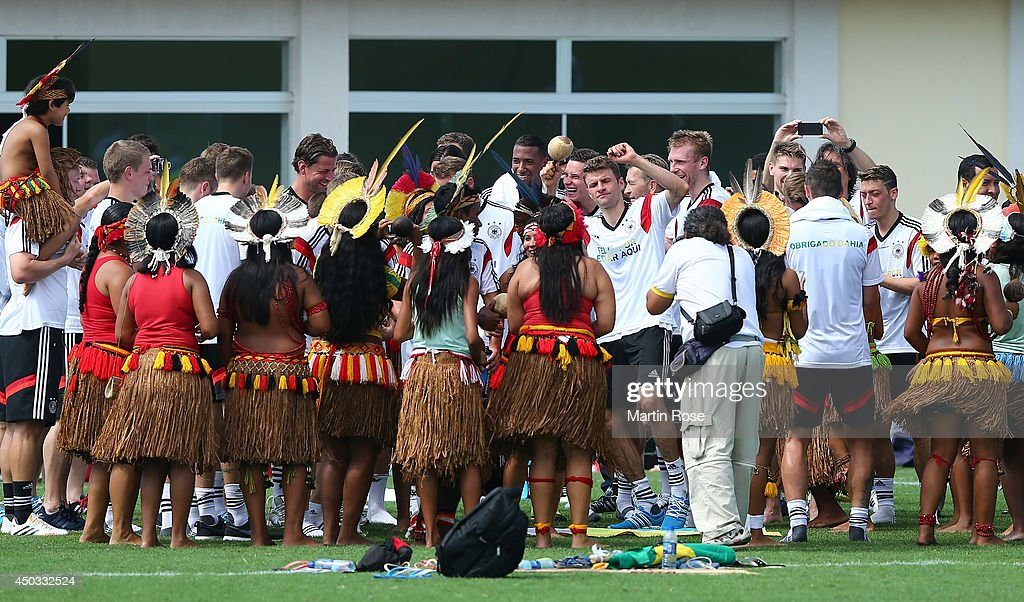 Thomas Mueller (C) , dance with Brazilian indigenous after the German National team training session at Campo Bahia on June 9, 2014 in Santo Andre, Brazil.