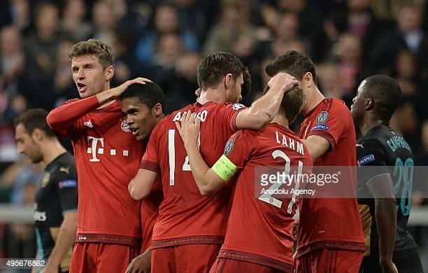 Thomas Mueller Douglas Costa Xabi Alonso Philipp Lahm and Robert Lewandowski of Bayern Munich celebrate a goal during the UEFA Champions League group...